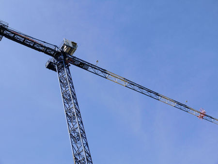 Construction crane on sky background