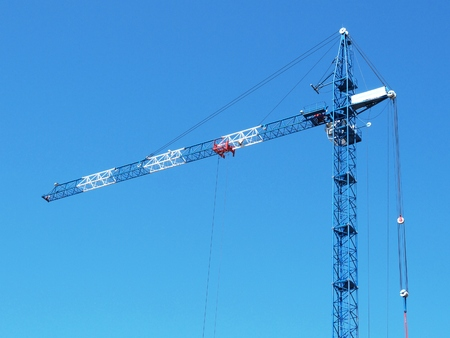 photo tower crane on a background of clear sky.