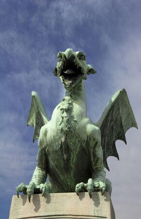 One of the four bronze dragons on the Dragon Bridge in Ljubljana Stock Photo