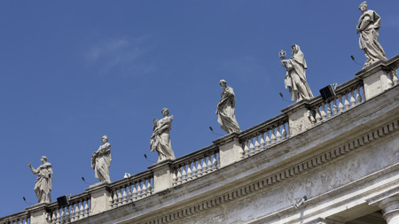peters:  Detail from the 140 Saints sculptures by Bernini atop the St. Peters Square Colonnade, Rome, Italy. Piazza San Pietro.