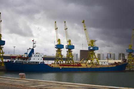 Cargo crane, ship, freight traine in port