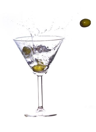 olives in a martini Splash on white background