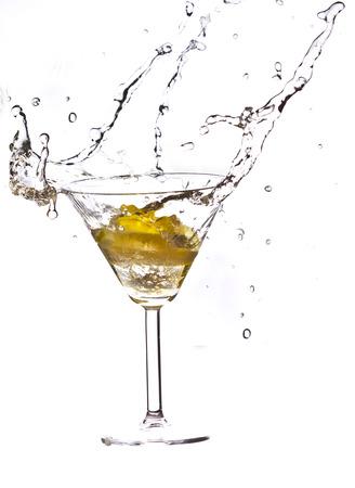 Lemon slice falling into cocktail