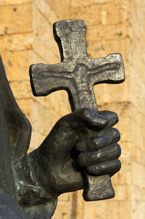 Religious statue hand and cross