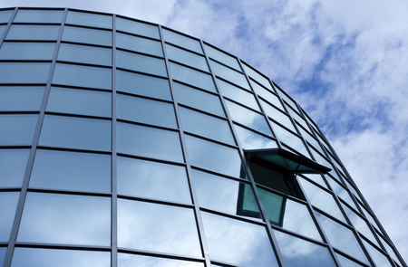 Modern office building with glass windows. Corporate background.