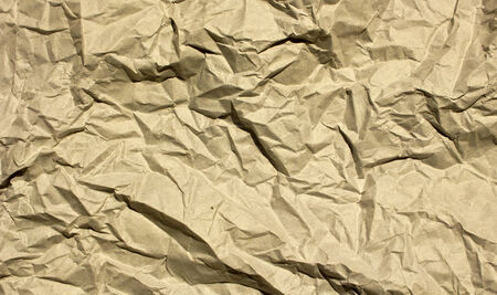 crinkle:  Photograph of wrinkled brown paper for use as a background. Add your text to the background.