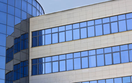 administrative buildings: Modern office building with glass windows. Corporate background
