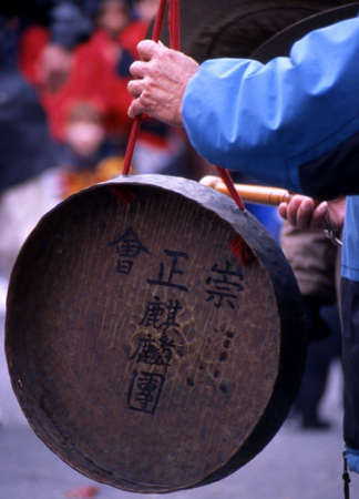 percussionist: The hand of a Chinese percussionist playing a cymbal in a Chinese New Years parade. Stock Photo