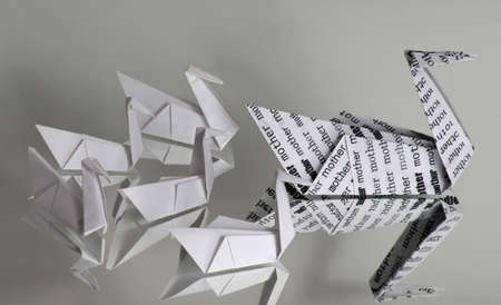 An origami swan covered with the word