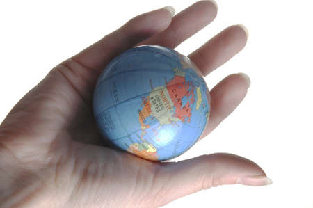 A miniature globe in the palm of a hand. The western hemisphere is visible.