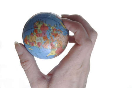 A hand holding a miniature globe. The western hemisphere is visible. Banco de Imagens - 422525
