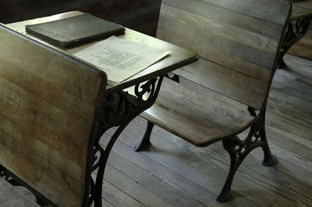 An old-fashioned wooden desk in a one-room school. Imagens