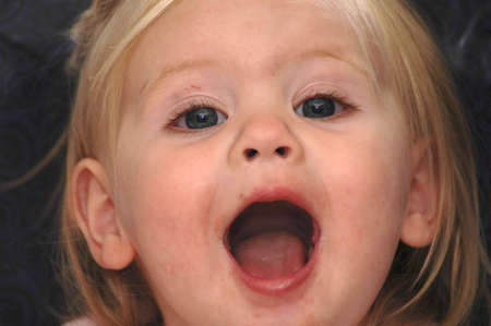 whose: A picture of a  girl whose mouth is open in exclamation.