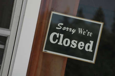 A sign on a cafe that says Sorry, were closed. Stock Photo