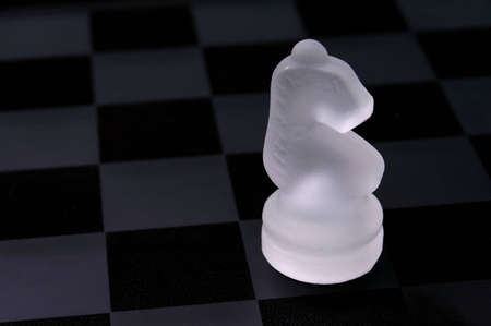 An opaque white knight from a glass chess set.