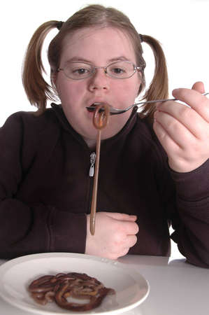 detestable: A woman eating a plateful of worms.