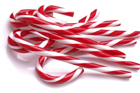 A pile of candy canes on a white background.