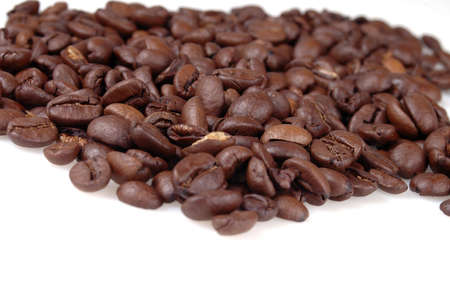 A pile of coffee beans against a white background.