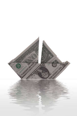 An illustration of staying financially afloat. A sailboat made of dollar bills appears to float on rendered water. White background.