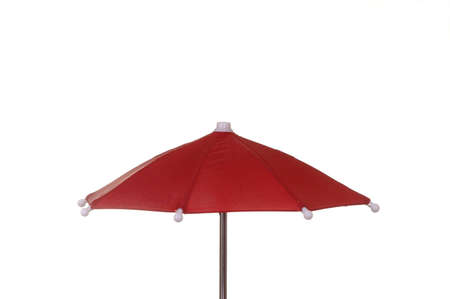 A bright red umbrella against a white background.