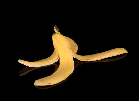 sabotage: A banana peel against a black background.