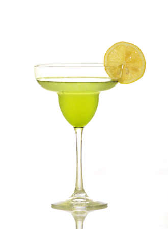 highkey: A martini decorated with a lemon. Shot against a white background.