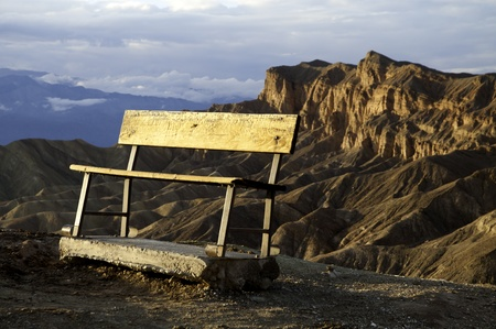 A bench overlooking a mountain vista in Death Valley National Park  Stock Photo - 16436982