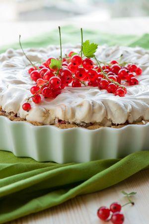 Redcurrant meringue tart in a baking dish photo