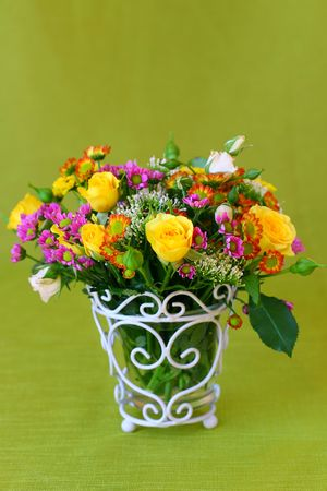Flowers arrangement in a vase photo