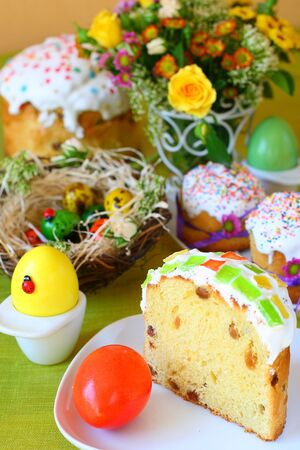 Easter table laid with sweet cake,pasha and eggs photo