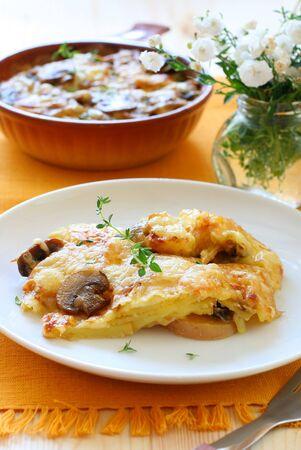 potato and mushroom gratin with cheese photo