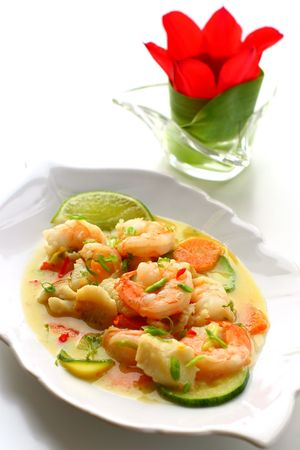 Seafood in coconut milk with vegetable photo