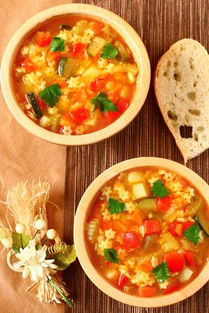 Delicious minestrone soup with bread photo