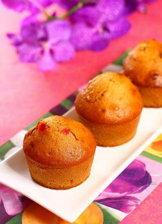 Tasty  honey muffins with cherry photo