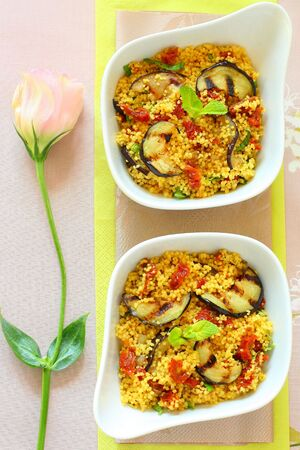 Couscous salad with grilled eggplants,dried tomatoes and mint photo