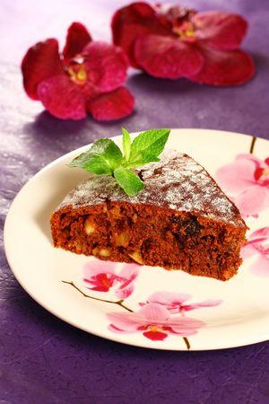 honey cake with nuts and raisins photo