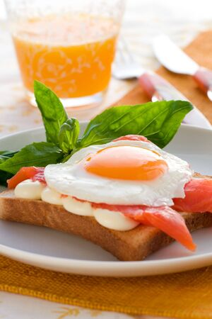 Fried eggs with salmon on toast photo