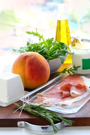 meal preparation: Ingredients for meal preparation Yoghurt, the goat cheese, olive oil, ham, rosemary,peach