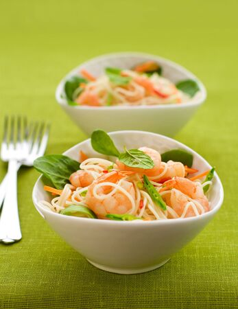 prawn noodle salad with baby spinach ,carrots and sugar snap peas photo