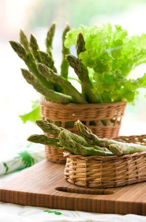 Fresh spring asparagus and lettuce photo
