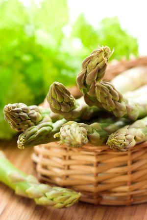Fresh spring asparagus in a basket photo