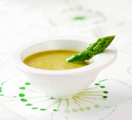 soup bowl: Fresh cream soup of  asparagus  and garnish.