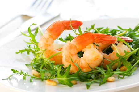 Salad with shrimps or prawn and arugula photo
