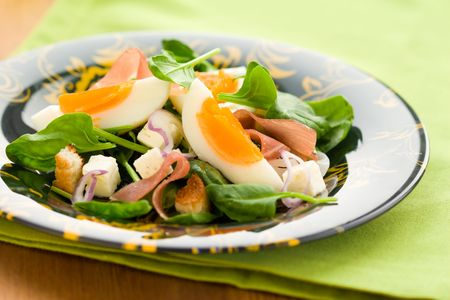 spring salad with spinach,egg,ham and feta photo