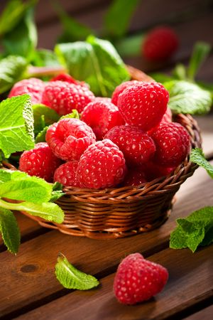 Fresh raspberries and mint in a basket Stock Photo - 6676205