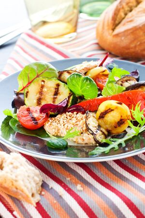 Grilled vegetables and chicken with sesame seeds Stock Photo