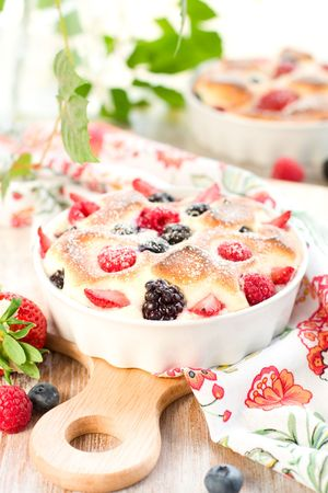 Fruit pudding(clafoutis) with berry: strawberry; raspberry; blueberry; blackberry photo