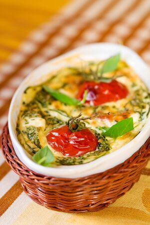 tomato gratin with cheese and zucchini  in baking dish  Stock Photo