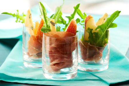 prosciutto: appetizer with pear,prosciutto,arugula,gorgonzola in glasses Stock Photo