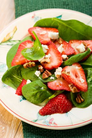 Spinach salad with strawberries,goats cheese and pecan nut  photo